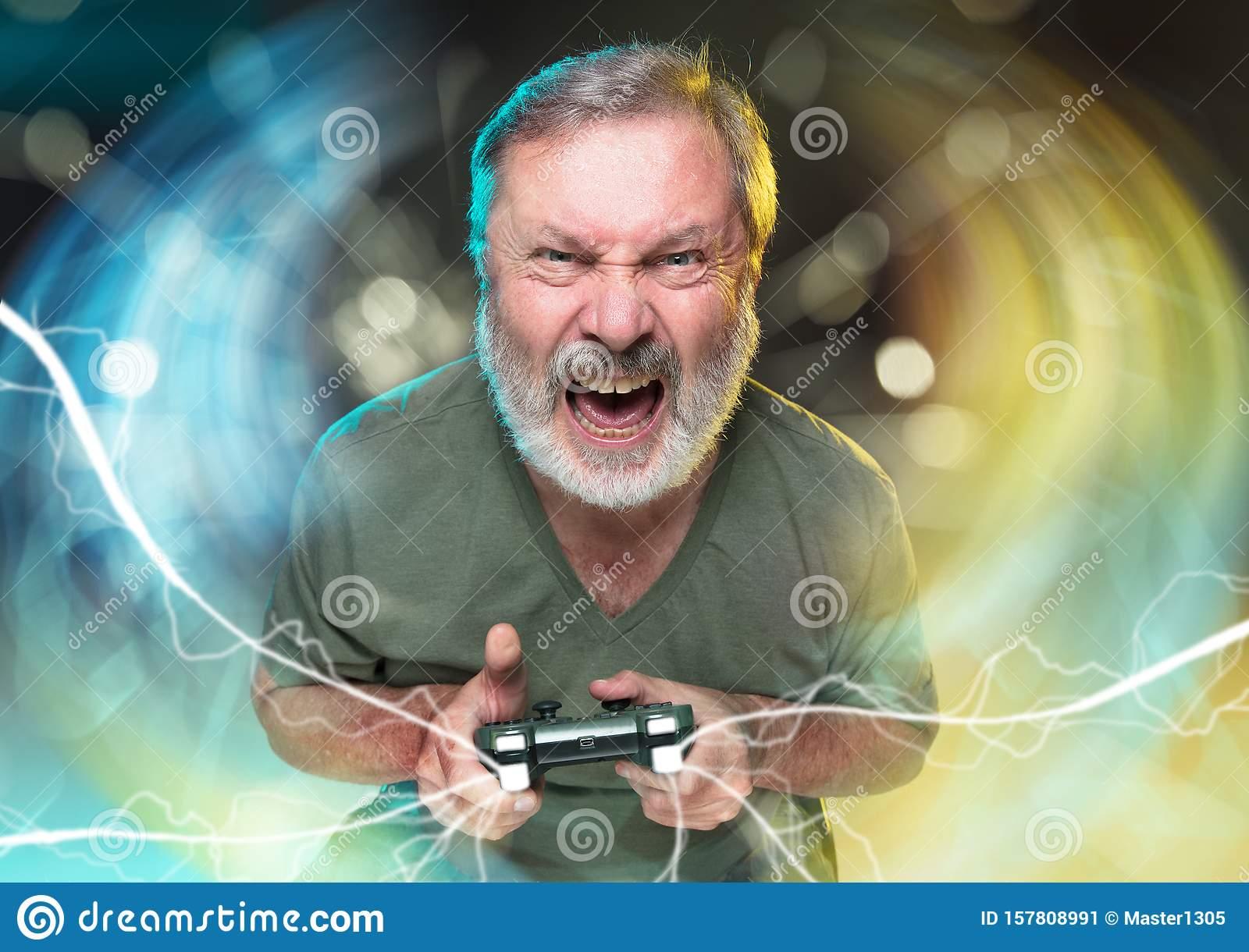enthusiastic-gamer-joyful-man-holding-video-game-controller-breathtaking-new-life-senior-man-holding-video-game-controller